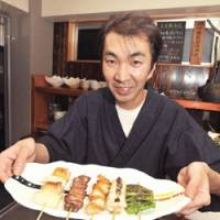 Finest fowl: Chef Kenji Yoshimoto uses only premium chicken at his yakitoriya, Yoshicho. Other popular dishes include ontama soboro-don, a rice bowl with chicken and egg, and skewers of shiitake and gingko nuts. | YOSHIAKI MIURA