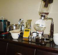 Lab work: Various methods of coffee brewing, including the siphon (right), are lined up for testing.