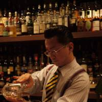 Infused with enthusiasm: High Five's Hidetsugu Ueno pours a martini with a splash of sperm-whale bile. | NICK COLDICOTT PHOTOS