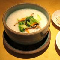 One of the specialties is kayu rice porridge (above), served throughout the day.