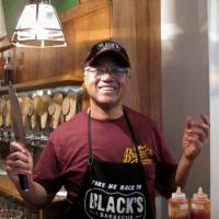 Knife to meat you: Taproom manager Chuck Morrow mans the barbecue pit. | ROBBIE SWINNERTON PHOTOS