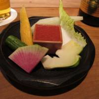 A starter plate of crudites with a tomato and miso dip.