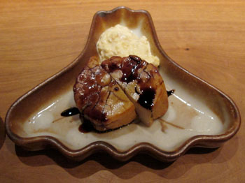 Meaty mollusk: Smoked scallop, served with a dip of chopped-onion