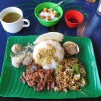 Square meal: Warung Bintang, in the back streets of Shibuya, serves a range of straightforward Indonesian street foods, including nasi campur, a selection of side dishes arranged around a mound of white rice. End your meal with a classic Balinese dessert — deep-fried banana with gritty coffee. | ROBBIE SWINNERTON PHOTO