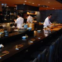 Ringside seats: Pull up at the counter to see Namikibashi Nakamura's chefs at work.   ROBBIE SWINNERTON PHOTOS