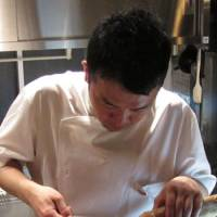A slice of France: Abasque's Chef Naoki Wada, here at work in his kitchen, lived in the French Basque Country for several years before bringing the region's recipes to Tokyo. | ROBBIE SWINNERTON PHOTOS