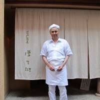 In good hands: Soba master Takashi Hosokawa stands in front of his eponymous noodle restaurant, where the menu includes yaki-miso made with buckwheat grains and scallion. | ROBBIE SWINNERON