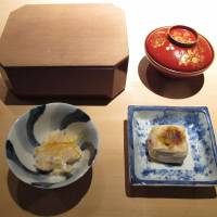 Less is more: Uchiyama serves delicately prepared traditional Japanese fare. Its bento lunch (above) comes with various starters, including the yaki-gomado fu in the bottom-right dish. | ROBBIE SWINNERTON PHOTOS