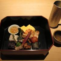 Box of delights: Uchiyama's bento is like a chef's special menu in miniature, housed in an elegant lacquerware box.