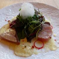 Morse and morsels: The prix-fixe lunch menu at code kurkku, part of the new Yoyogi Village development in Tokyo, includes lightly seared buri (yellowtail) with apple and daikon sauce (above), and pan-fried  jidori (free-range chicken) fricasseed with organic spring vegetables.   ROBBIE SWINNERTON