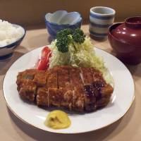Katsu cradle: Tonki has prepared its distinctive tonkatsu (deep-fried breaded pork cutlets) since 1939. The cutlets are deep-fried slowly and taste more home-cooked than those at other more modern restaurants. | ROBBIE SWINNERTON PHOTOS