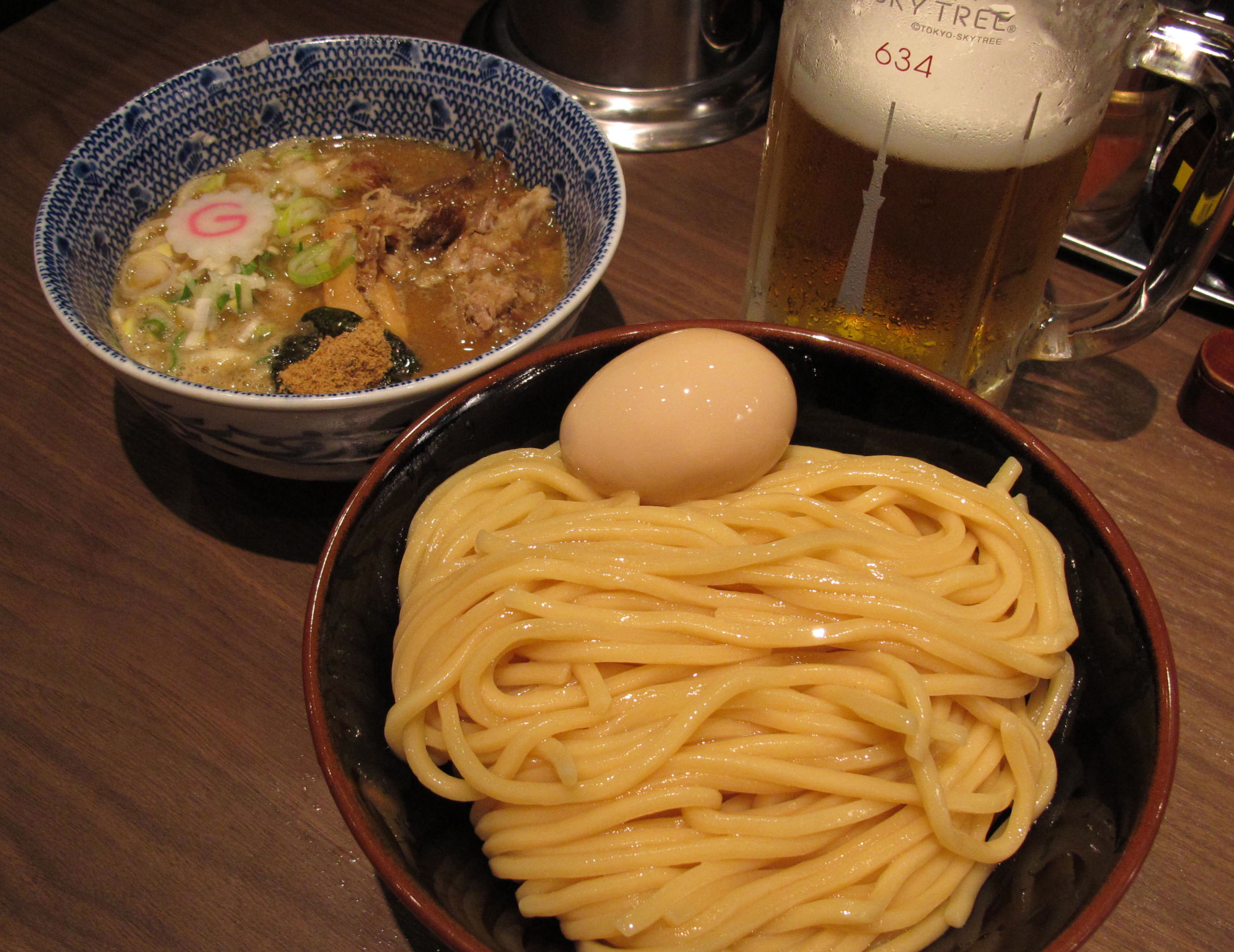 Dipping into Rokurinsha: Tsukemen with Rokurinsha's trademark ajitama egg and a Skytree beer (above), served with a smile from staff (below) and definitely worth the wait (bottom). | ROBBIE SWINNERTON PHOTOS