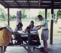 Words and wisdoms: Tasaku Tsunoda (right), now the only speaker of Warrongo, teaches the language to Rachel Cummins (center), a granddaughter of his teacher, Alf Palmer, and her daughters in Townsville, Queensland, in March 2002. | MIE TSUNODA PHOTO