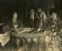 Home comforts: Standing in the shadows in this family photo from the mid-1920s, Taeko Tomiyama poses at home in Kobe with her mother (left), father and an aunt. | TAEKO TOMIYAMA PHOTO