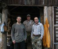 At the sharp end: Tiger trappers Kolya (left), Dale (center) and Vova live in the forest for months at a time to radio-collar the beasts in aid of conservation. | PATRICK EVANS PHOTO