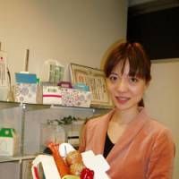 Eco packs: Asako Hirai of the Doggy Bag Committee displays various reusable doggy bags made of plastic that even allow diners to take liquid leftovers home.
