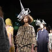 Getting ahead: Experiments in textiles by Hokuto Katsui and Nao Yagi of Mintedesigns are reaping their rewards as the label's business in Asia booms. Here, a model is topped off with something apparently inspired by European half-timbered houses. | MISHA JANETTE PHOTO