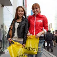 Out on the town: Akane Kanatsu (left) and Rina Yoshimoto, both 18, had this to say about shopping from fast-fashion chain stores: 'H&M is cheap and we like that. The quality is also reasonable considering the prices. We come to Harajuku about once a month, and actually we prefer Forever 21 to H&M because we find H&M is more adult and Forever 21 is more fashionable for us. The prices, though, are good for teenagers.' | WILL ROBB PHOTO