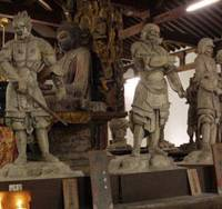 War lords: Some of the '12 Heavenly Generals' who protect the central Buddhist statue at Shin Yakushiji Temple in Nara.