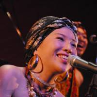 Out of Africa: Eriko Mukoyama, whose stage name of Anyango means 'girl born in the morning,' sings a song in Dholuo, the language of Kenya's Luo tribe, at a Tokyo concert in October 2009. | MISA INAGE PHOTO