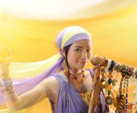 Reaching out: Eriko Mukoyama, whose stage name is Anyango, poses here with her nyatiti. On May 30, she releases her second album, titled 'Horizon.' | TAISIROU SATOU PHOTO