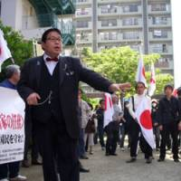 Preaching to the converted: Makoto Sakurai calls for Japan-born schoolgirl Noriko Calderon to be sent 'back to the Philippines2 — a country she had never visited — at a rally in Warabi, Saitama Prefecture, last year.   DAVID MCNEILL PHOTO