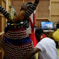 Showtime:  The Anambra State Union troupe's Odogwu mask dancer prepares to take the stage at Africa Fair.    DREUX RICHARD