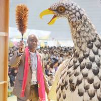 Mission accomplished: Anambra State Union Chairman  Tony Ikeotuonye — flanked by the Ugo — brings his troupe's Africa Fair performance to a close.  | DREUX RICHARD
