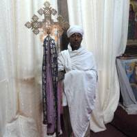 A priest at Lalibela's rock-hewn church of Bet Amanuel (St. Emanuel). | LESLEY DOWNER PHOTO
