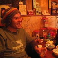 Swill and chill: Chiku downs one of many drinks at a downtown Sendagi bar last month.   SIMON BARTZ PHOTO