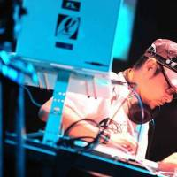 Hitting the deck: DJ Krush at the turntables