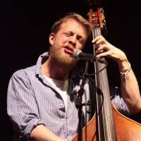 Mumford and Sons bassist to undergo surgery