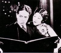 Looking back: Isamu Kosugi (left) and Takako Irie star in 'Tokyo March,' which is part of the Talking Silents series being screened in Akasaka. | © DIGITAL MEME