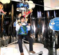 Up, up and away!: A man tries out a real-life interpretation of Doraemon's 'take-copter' at a Doraemon-themed exhibition in Tokyo. | TOMOKO OTAKE PHOTO