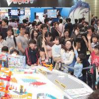 Play time: Children check out toys at last year's International Tokyo Toy Show.