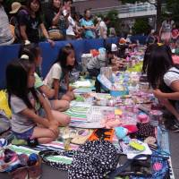 Second life: A flea market run by children was one of the highlights at last year's Mottainai Festa. The event encourages eco-consciousness via the reuse of old products.