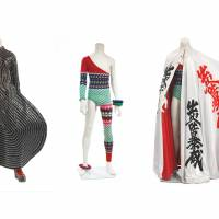 A space oddity: (left to right) 'Tokyo Pop' vinyl bodysuit (1973), designed by Kansai Yamamoto for the Aladdin Sane tour; Asymmetric knitted bodysuit (1973), designed by Kansai Yamamoto for the Aladdin Sane tour; cloak decorated with kanji characters (1973), designed by Kansai Yamamoto for the Aladdin Sane tour. | THE DAVID BOWIE ARCHIVE