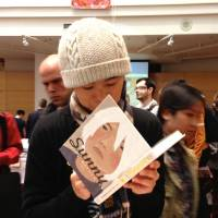 Taiyo Matstumoto signs a copy of his 'Sunny' at the Toronto Comic Arts Festival . | ANNE ISHII