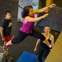 Leaps and bounds: Instructor Salil Maniktahla, left, observes a participant jump to a wall as part of a parkour class at Urban Evolutions in Alexandria, Virginia. | THE WASHINGTON POST