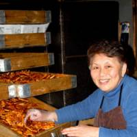 Katsuko Sato of Tekona, who bakes her crackers for their crunch.