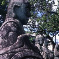 Past continuous: Rakan figures in a park commemorate long-dead victims of a famine. Hachiman-gu.