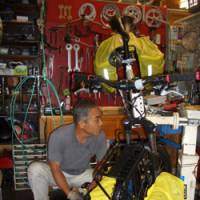 Local service: Yoshikazu Mori offers osettai, a gift to pilgrims, in this case free bicycle repairs, at his bicycle repair shop in Tosa-Shimizu, Kochi Prefecture.