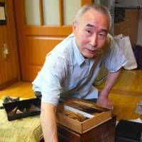 Heirloom traditions: Master craftsman Hitoshi Maeda displays tools he uses to make fine lacquerware, which with a bit of care, he says, will last generations.