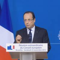 Euro-politics: French President Francois Hollande addresses a news conference following the European Union leaders' summit held at the headquarters of the European Council in Brussels last November. | BLOOMBERG
