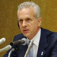 We come in peace: Louis Foster, senior managing director at Cerberus Capital Management LP, speaks at a news conference Monday in Chiyoda Ward, Tokyo. | KYODO