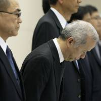 Damage control: Naomi Hirose, president of Tokyo Electric Power Co., bows during a news conference at the utility's headquarters last Nov. 7. | BLOOMBERG