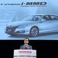 Pay to be economical: Honda Motor Co. President Takanobu Ito faces reporters Thursday in Tokyo's Shibuya Ward. | KYODO