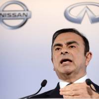 On top: Nissan Chief Executive Officer Carlos Ghosn holds a news conference at the automaker's headquarters in Yokohama in May. | AFP-JIJI