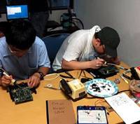 Tokyo Hackerspace participants work on a project.