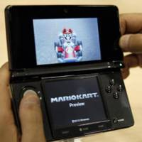Hand-held high definition: A visitor uses a Nintendo 3DS during a press conference in Chiba last week. | AP PHOTO